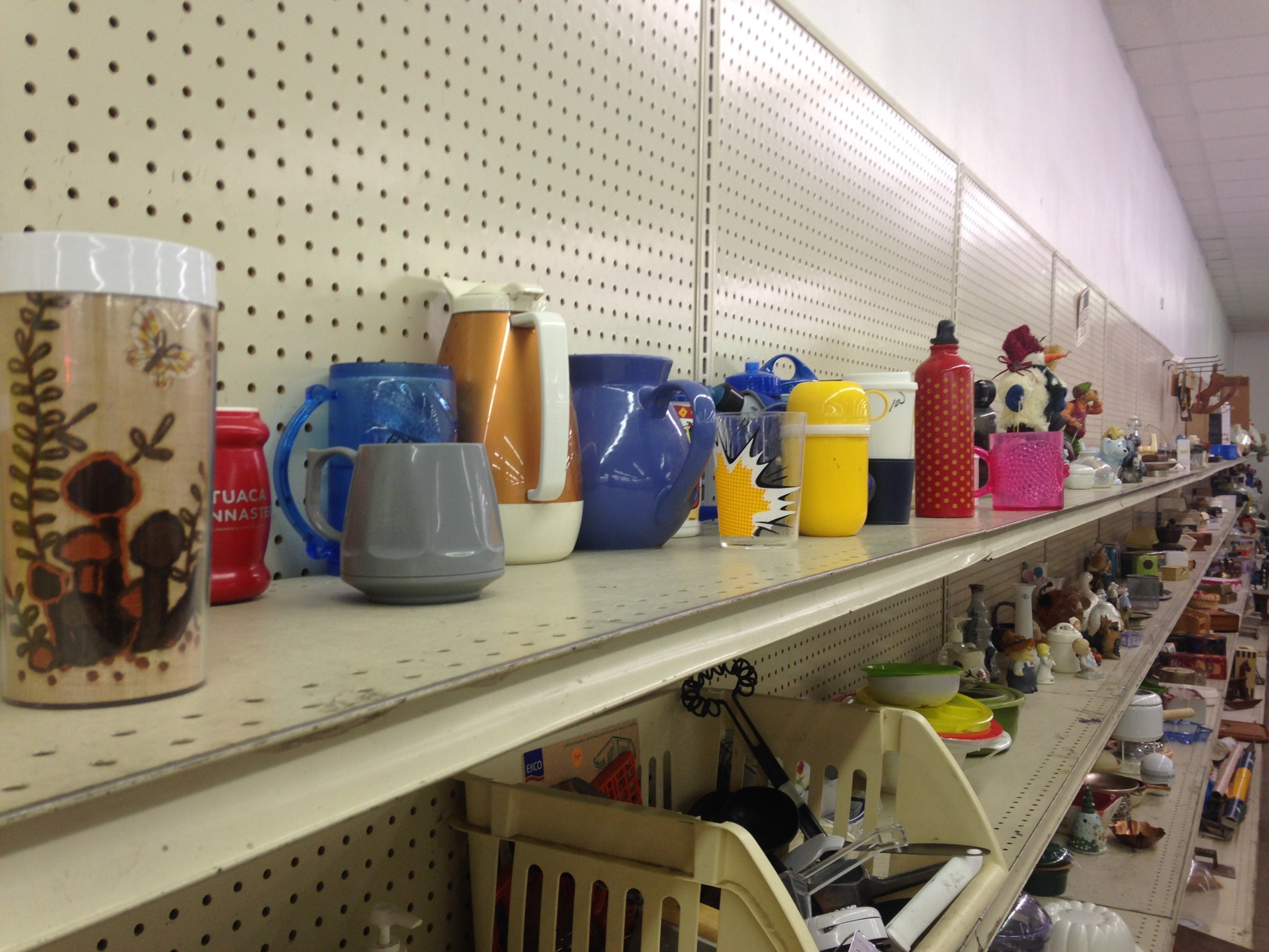 Plastic Thermoses And Kettles Sit Next To Porcelain Knickknacks In Value  Villageu0027s Oddball Assortment Of Housewares