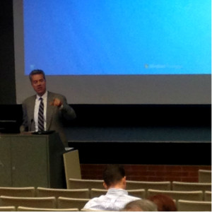 Chancellor Mark Mone speaking at the UWM forum.