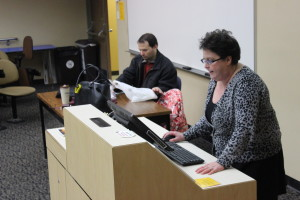 Sam Dorios takes attendance while Murphy-Lee prepares her presentation for the day. Photo by Hunter Hanthorn.