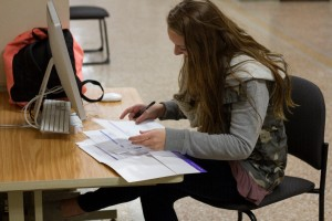 During a break between classes, Elsner goes over paperwork from the fertility clinic. Photo by Mary Jo Contino