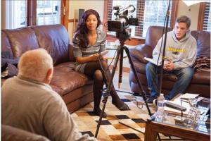 Photo of Amanda Porter and Dan Zielinski interviewing survivor Nate Taffel courtesy of UWM PR.