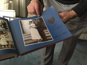 Melton points to a photo of his wife Evelyn and him on their wedding day. Photo credit: Mary Jo Contino
