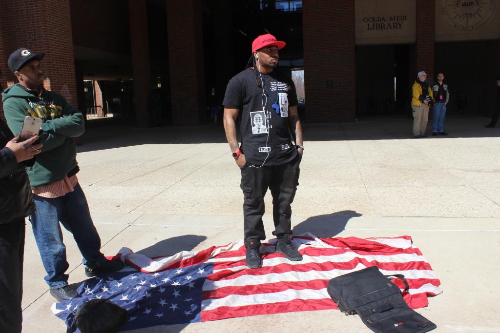 Vaun Mays was protesting Trump's slogan, in part. Photo by Brandon Hartman.