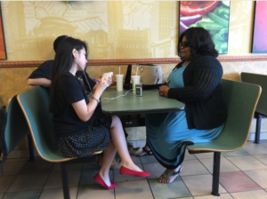 Media Milwaukee journalist Pakou Lee interviewing Yancey's sister, Sasha. Photo by Emily Zantow.